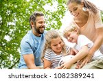 family playing with ball during ... | Shutterstock . vector #1082389241