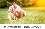 woman hugs and cuddles golden... | Shutterstock . vector #1082389277