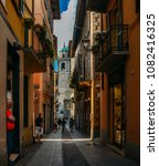 Small photo of Bellagio, Italy - April 26, 2018: Small alleyway leading to a historic church