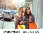 happy young women with shopping ... | Shutterstock . vector #1082431421