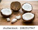 broken coconut on a wooden... | Shutterstock . vector #1082517947