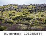 Black Volcanic Rocks Covered...