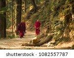 three buddhist monks are... | Shutterstock . vector #1082557787