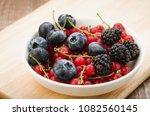 abundance of berries in a white ...   Shutterstock . vector #1082560145