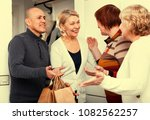 mature friends are visiting... | Shutterstock . vector #1082562257