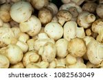 champignons in boxes on the... | Shutterstock . vector #1082563049