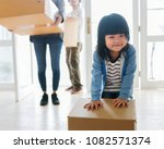 asian family emoving to new... | Shutterstock . vector #1082571374