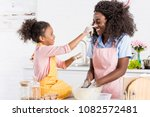 african american mother and... | Shutterstock . vector #1082572481