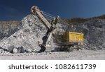 heavy excavator inside the...   Shutterstock . vector #1082611739