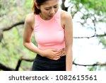 woman runner side cramp while... | Shutterstock . vector #1082615561