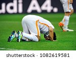 Small photo of MILAN, ITALY-MAY 07, 2017: AS Roma's egyptian soccer player, Momamed Salah, prays as a muslim does, after score during the italian league match AC Milan vs AS Roma, at the san siro stadium, in Milan.