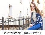beautiful young woman drinking... | Shutterstock . vector #1082619944