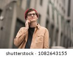 a young teenage boy  a hipster  ... | Shutterstock . vector #1082643155