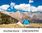 a single blue tent seen against ... | Shutterstock . vector #1082646944