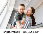 mom and son playing at home. | Shutterstock . vector #1082651534