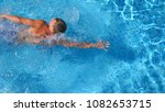 top view of sporty man swimming ... | Shutterstock . vector #1082653715