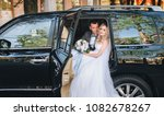 beautiful newlyweds in a car... | Shutterstock . vector #1082678267