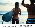 couple of surfers standing on... | Shutterstock . vector #1082681795