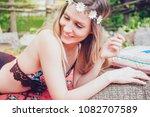 beautiful hipster girl lying in ... | Shutterstock . vector #1082707589