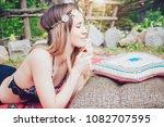 beautiful hipster girl lying in ... | Shutterstock . vector #1082707595