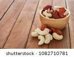 cashew nuts on a  wooden floor | Shutterstock . vector #1082710781