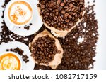 bag of coffee beens on white... | Shutterstock . vector #1082717159