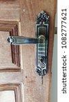 wooden door and doorknob   Shutterstock . vector #1082777621