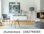patterned pouf near fireplace... | Shutterstock . vector #1082798585