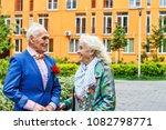 pair of elderly handsome people ... | Shutterstock . vector #1082798771