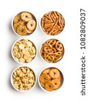 mixed salty snack crackers and... | Shutterstock . vector #1082809037
