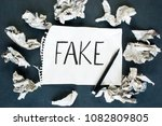word fake written on a sheet of ... | Shutterstock . vector #1082809805
