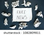 word fake written on a sheet of ... | Shutterstock . vector #1082809811
