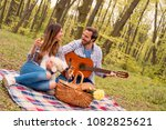 lovely young couple enjoying... | Shutterstock . vector #1082825621