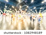 Small photo of Vintage blurred people at sport event in conventional hall, expo fair to pickup running t-shirt. Wide view bohek crowd of people 5K, 10K, half, full marathon race preparation in Houston, Texas, USA