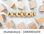 annual word on wooden cubes | Shutterstock . vector #1083001655