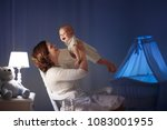 mother and baby reading a book... | Shutterstock . vector #1083001955