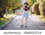 beautiful girl in a black hat... | Shutterstock . vector #1083023714