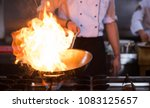 chef cooking and doing flambe... | Shutterstock . vector #1083125657