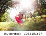 mother carry a one year old... | Shutterstock . vector #1083151637