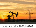 view of a pumpjack at sunset...