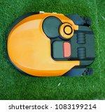 robot lawn mower on grass ... | Shutterstock . vector #1083199214
