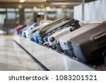 wheeled suitcase on a luggage... | Shutterstock . vector #1083201521