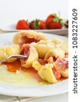 Small photo of Strawberry dumplings smothered in strawberry sauce. Selective focus