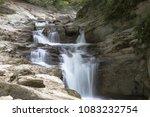 Stock photo waterfall at autumn forest selva de irati fall beech jungle in navarra pyrenees of spain cascade 1083232754