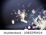sparkler glowing in the dark | Shutterstock . vector #1083290414