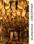 iberian cured hams stored in a... | Shutterstock . vector #1083295469