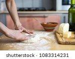 senior woman hands knead dough... | Shutterstock . vector #1083314231