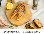 salmon steak on plate | Shutterstock . vector #1083314249