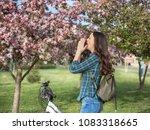 young pretty girl sneezing in... | Shutterstock . vector #1083318665