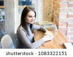 young beautiful woman sitting...   Shutterstock . vector #1083322151